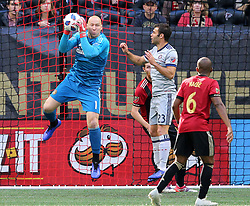 October 21, 2018 - Atlanta, GA, USA - Atlanta United goalkeeper Brad Guzan blocks a shot in front of Chicago Fire forward Nemanja Nikolic during the second half on Sunday, Oct. 21, 2018 in Atlanta, Ga. (Credit Image: © Curtis Compton/Atlanta Journal-Constitution/TNS via ZUMA Wire)