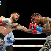 HOLLYWOOD, FL - APRIL 17:  Ortha Jones III defends a punch by Jorge Castaneda during their fight at Seminole Hard Rock Hotel & Casino on April 17, 2021 in Hollywood, Florida. (Photo by Alex Menendez/Getty Images) *** Local Caption *** Ortha Jones III; Jorge Castaneda