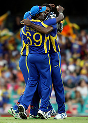 © Licensed to London News Pictures. 17/02/2012. Sydney Cricket Ground, Australia. Angelo Matthews hugs bowlers Farveez Maharoof after getting the wicket of Peter Forrest during the One Day International cricket match between Australia Vs Sri Lanka. Photo credit : Asanka Brendon Ratnayake/LNP