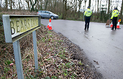 © Licensed to London News Pictures 12/03/2021. Ashford, UK. Police officers stand guard on Bears Lane. Teams of Metropolitan police officers continue to search Great Chart Leisure in Ashford, Kent today in connection with the ongoing investigation into the disappearance of Sarah Everard from London. Photo credit:Grant Falvey/LNP