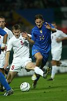PARMA, 13-10-04<br />Qualificazioni Mondiali<br />Italia Bielorussia<br />nella  foto Totti e Shtanyuk<br />Foto Snapshot / Graffiti