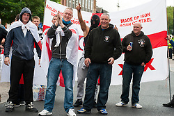"""Rotherham England<br /> 13 September 2014 <br /> Representatives of the EDL Teesside Division form up outside Rotherham Town Hall before taking part in a march down to Rotherham Police Headquarters on Saturday Afternoon described by an EDL Facebook Page as """"a protest against the Pakistani Muslim grooming gangs"""" on Saturday Afternoon <br /> <br /> Image © Paul David Drabble <br /> www.pauldaviddrabble.co.uk"""