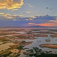 A sunset glows over the marshy shoreline of Utah's Great Salt Lake, near Salt Lake City.