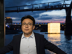 © Licensed to London News Pictures. 31/08/2016. London, UK. 'Floating Dreams' a major, illuminated, floating installation by Korean artist Ik Joong Kang (pictured) is unveiled on the River Thames as part of Totally Thames Festival 1-30 Sept 2016. Photo credit: Peter Macdiarmid/LNP