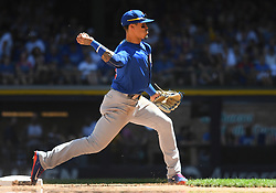 June 13, 2018 - Milwaukee, WI, U.S. - MILWAUKEE, WI - JUNE 13: Chicago Cubs Second base Javier Baez (9) throws to 1st during a MLB game between the Milwaukee Brewers and Chicago Cubs on June 13, 2018 at Miller Park in Milwaukee, WI. The Brewers defeated the Cubs 1-0.(Photo by Nick Wosika/Icon Sportswire) (Credit Image: © Nick Wosika/Icon SMI via ZUMA Press)