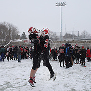Matthew Hall, (left), and Matthew Cognetta, New Canaan, celebrate victory during the New Canaan Rams Vs Darien Blue Wave, CIAC Football Championship Class L Final at Boyle Stadium, Stamford. The New Canaan Rams won the match in snowy conditions 44-12. Stamford,  Connecticut, USA. 14th December 2013. Photo Tim Clayton
