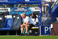 AFC Wimbledon manager Glyn Hodges sat on box watching the game during the EFL Sky Bet League 1 match between AFC Wimbledon and Plymouth Argyle at the Kiyan Prince Foundation Stadium, London, England on 19 September 2020.