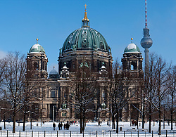 Berlin Cathedral in the snow in Mitte district of Berlin Germany