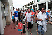 """'Petit Payo' leads the Baptiste gitan pilgrim family to the church to carry the statue of Sara to the sea <br /><br />""""Le Pelerinage des Gitans""""; the French gypsy pilgrimage of Saintes Maries de la Mer, Camargue, France<br /><br />Sainte Sara is an uncannonized saint, who legend says looked after the Christian Saints Marie Jacobe and Marie Salome, cousins of Mary Magdalene, who arrived, it is said, on the shores of the Camargue in a rudderless boat. Saint Sara is the patron saint of gypsies who come from far and wide to see her. There are even paintings of Sara as 'Kali' the black saint in Eastern Europe. Sara may have been the priestess of 'Ra' the sun-god or even servant girl to the Christian saints. No-one really knows.<br /><br />For a few weeks of the year, Roma, Gitan and Manouche gypsies come from all over Europe in May, camping in caravans around Saintes Maries de la Mer. It is a festive time where they play music, dance, party and christen their children. They all go to see Saint Sara in the crypt, kissing or touching her forehead. Many put robes on her shoulders, making her fat for the procession. In the main Gypsy procession of the 24th May, Saint Sara is allowed to leave her crypt, beneath the church, and is carried from the church to the shores of the mediterranean and back again. One day a year she is free from her prison. Hundred's of years ago the Gypsies used not even to be allowed into the church, only into the crypt like Sara...<br /><br />Roma gypsies still suffer oppressive prejudice and racism and are one of the ethnic groups the most persecuted and marginalised across Europe. The festival is one of the times where they celebrate with people of all races, their faith and traditions"""