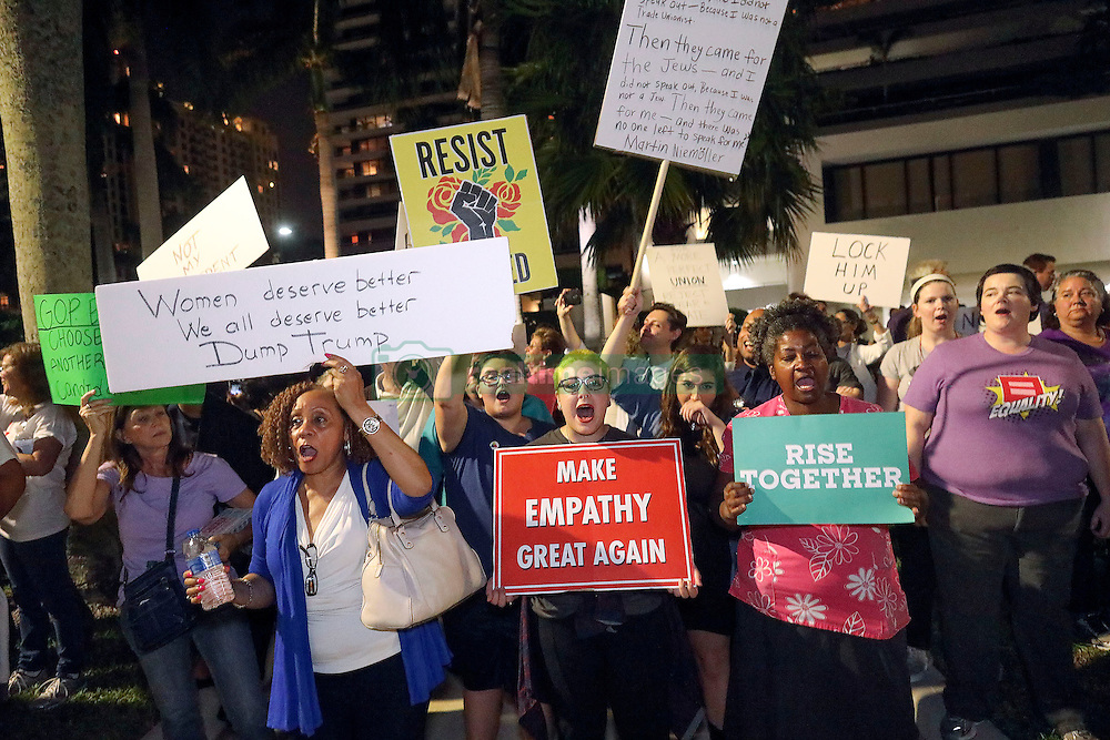November 11, 2016 - Florida, U.S. - People protest against the election of Donald Trump as the 45th President of the United States Friday, November 11, 2016 in front of the luxury condominium towers that bear his name along the waterfront in West Palm Beach, FL.  Damon Higgins / The Palm Beach Post (Credit Image: © Damon Higgins/The Palm Beach Post via ZUMA Wire)