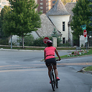 Woman bicycle rider in the morning near the Country Club Plaza In Kansas City, MO.