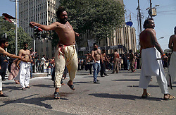 October 1, 2017 - Pakistan - KARACHI, PAKISTAN, OCT 02: Devotees of Imam Hussain scorching themselves by .knives during procession in connection of 10th Muharram-ul-Haram, in Karachi on Sunday, .October 01, 2017. (Credit Image: © PPI via ZUMA Wire)