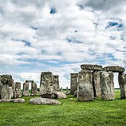 Stonehenge with Partly Cloudy Sky. Believed to have been built somewhere between 2000 and 3000 BC, Stonehenge is one of the United Kingdom's most distinctive landmarks. It's function and purpose remains a matter of conjecture, although many theories have been offered. It consists of a series of large standing stones, some of which have toppled over the centuries. Stonehenge is located in Salisbury Plain west of London.