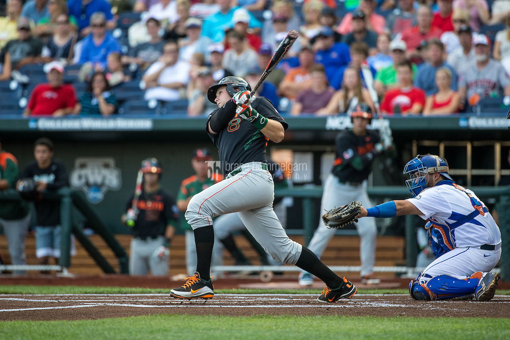 David Thompson (8) of the Miami Hurricanes bats during a game between the Miami Hurricanes and Florida Gators at TD Ameritrade Park on June 13, 2015 in Omaha, Nebraska. (Brace Hemmelgarn)