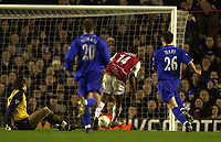 Photo. Richard Lane. <br />Arsenal v Chelsea. FA Cup Fifth Round. 08/03/2003<br />Thierry Henry slots home Arsenal's second goal.