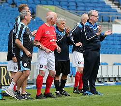 England's Tommy Charlton (middle) gets ready to go on the pitch for his England debut during the Walking Football International match at The AMEX Stadium, Brighton.