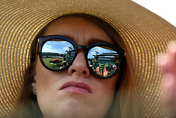 The action on the outside courts is reflected in a spectators sunglasses on day ten of the Wimbledon Championships at the All England Lawn Tennis and Croquet Club, Wimbledon. PRESS ASSOCIATION Photo. Picture date: Thursday July 12, 2018. See PA story TENNIS Wimbledon. Photo credit should read: Nigel French/PA Wire. RESTRICTIONS: Editorial use only. No commercial use without prior written consent of the AELTC. Still image use only - no moving images to emulate broadcast. No superimposing or removal of sponsor/ad logos. Call +44 (0)1158 447447 for further information.
