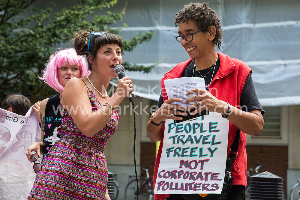London, UK. 29 July, 2019. May McKeith addresses activists from Reclaim the Power, All African Women's Group, Docs Not Cops, Lesbians and Gays Support the Migrants and other groups at a protest outside the Home Office to demand an end to the Government's 'hostile environment' policies.