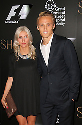 Chloe Roberts; Max Chilton; Marussia, F1 Party in aid of Great Ormond Street Hospital Children's Charity, Victoria and Albert Museum, London UK, 02 July 2014, Photo by Richard Goldschmidt © Licensed to London News Pictures. 03/07/2014