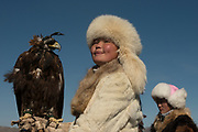 The Eagle Huntress with her eagle<br /> Aisholpan Nurgaiv Almaguil Kugsege<br /> Golden Eagle Festival<br /> in Bayan Olgii province<br /> Western Mongolia