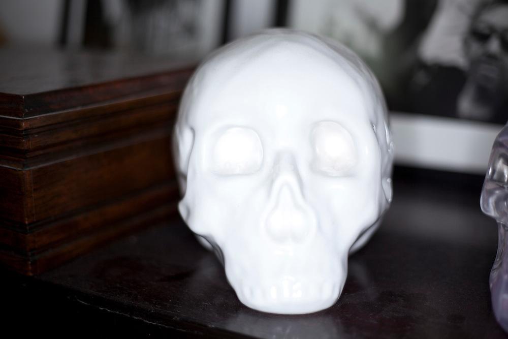 overexposed fake human skull made from white porcelain