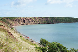 View from cliff tops North of Filey North Yorkshire towards Filey Brigg and the Cleveland Way footpath that heads up the east coast towards Scarborough