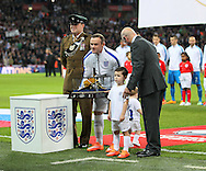 England's Wayne Rooney gets presented with his 100th cap<br /> <br /> - International European Qualifier - England vs Slovenia- Wembley Stadium - London - England - 15th November 2014  - Picture David Klein/Sportimage