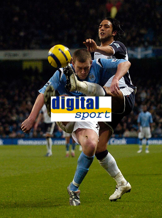 Photo: Jed Wee.<br /> Manchester City v Tottenham Hotspur. The Barclays Premiership. 04/01/2006.<br /> <br /> Tottenham's Mido (R) tries to win the ball from Manchester City's Richard Dunne.