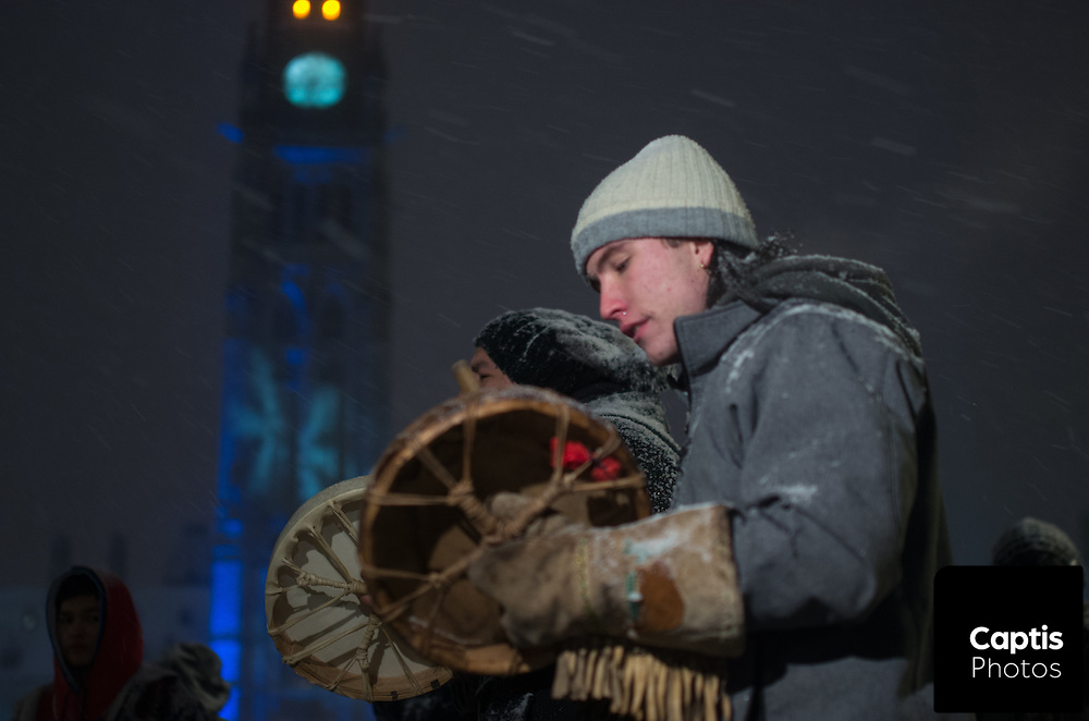 """Men play drums while people dance around them during a drum circle on Parliament Hill. The drum circle was held to commemorate the second anniversary of the """"Idle No More"""" movement. December 10, 2014. CAPTIS PHOTOS/Brendan Montgomery"""
