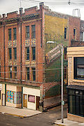 Wrigley's Spearmint Gun advertisment painted on side of historic brick building as viewed from a window of the Hotel Finlen