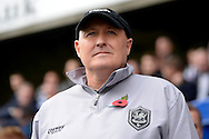 Cardiff City Manager Russell Slade looking on in the dugout before k/o. Skybet football league championship match , Millwall v Cardiff city at the Den in Millwall, London on Saturday 25th October 2014.<br /> pic by John Patrick Fletcher, Andrew Orchard sports photography.