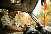 A Michigan Fly Fishing guide drives his truck.