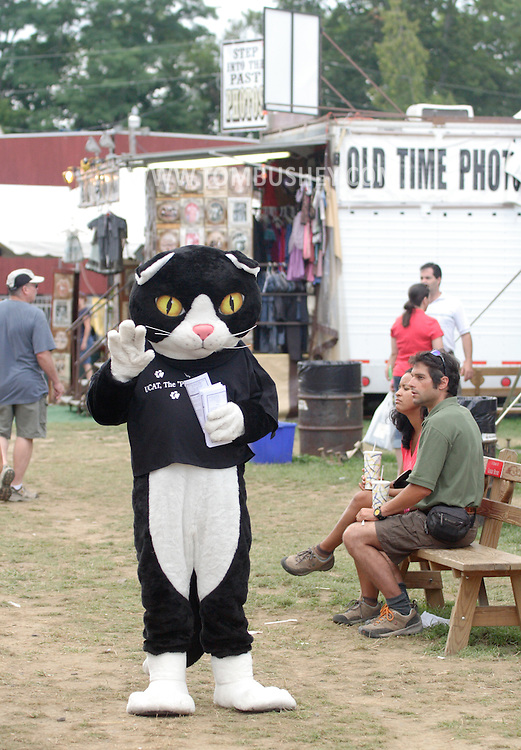 New Paltz, NY - A person wearing a cat costume waves to people at the Ulster County Fair on Aug. 3, 2008.