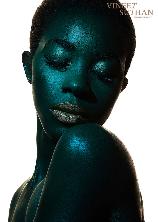 Editorial Fashion Photography using Profoto B1 lights. Black reflectors were used on the side of the portrait. Profoto beauty dish with blue gel was used for the light. A dark Model was chosen to photograph this scene. Captured with Phaseone IQ 250