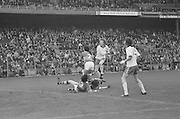 Kerry players fall to the ground in front of their own goalmouth during the All Ireland Minor Gaelic Football Final, Tyrone v Kerry in Croke Park on the 28th September 1975.