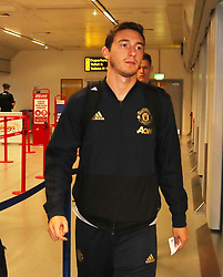 Matteo Darmian of Manchester United is spotted on his way to catch a flight as the team fly to Turin on Tuesday afternoon to play Juventus in The Champions League on Wednesday night.