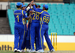 © Licensed to London News Pictures. 17/02/2012. Sydney Cricket Ground, Australia. The Sri Lankan team celebrate the wicket of Ricky Ponting during the One Day International cricket match between Australia Vs Sri Lanka. Photo credit : Asanka Brendon Ratnayake/LNP
