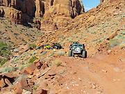 Jeeps crawl through Pritchett Canyon near Moab, Utah during Jeep Week 2018.