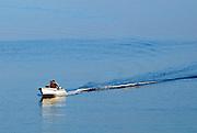 Fishing boat returning to harbour at dawn, Racisce, island of Korcula, Croatia