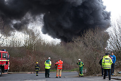 "© Licensed to London News Pictures . 15/03/2015 . Salford , UK . Emergency services at the scene . Roads are closed and people have been evacuated as a large fire burns at a unit within "" Junction Eco-Park "" in Clifton , Greater Manchester , this evening (Sunday 15th March 2015) . The smoke and flames can be seen for many miles . Forty fire fighters are at the scene working to control the blaze . Photo credit : Joel Goodman/LNP"