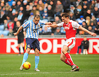 Coventry City's Joe Cole  gets a shot on target as he is closed down by Fleetwood Town's Eggert Jonsson<br /> <br /> Photographer Andrew Vaughan/CameraSport<br /> <br /> Football - The Football League Sky Bet League One - Coventry City v Fleetwood Town - Saturday 27th February 2016 - Ricoh Stadium - Coventry   <br /> <br /> © CameraSport - 43 Linden Ave. Countesthorpe. Leicester. England. LE8 5PG - Tel: +44 (0) 116 277 4147 - admin@camerasport.com - www.camerasport.com