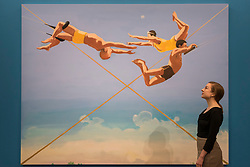 """© Licensed to London News Pictures. 08/09/2017. London, UK. A staff member views """"Three Aerialists"""", 2004, by Verne Dawson (Est. GBP50-70k), at a preview of 'Shake It Up', a collection of contemporary artworks from the personal collection of celebrity photographer Mario Testino. Proceeds from the upcoming auction of the collection at Sotheby's in London will benefit Museo Mate in Lima, Peru.  Photo credit : Stephen Chung/LNP"""