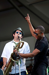 05 May 2013. New Orleans, Louisiana,  USA. .New Orleans Jazz and Heritage Festival. JazzFest..Troy Trombone Shorty with sax player Dan 'Uncle Potato Chip' Oestreicher and his band Orleans Avenue close the festival on the Acura stage..Photo; Charlie Varley