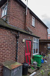 © Licensed to London News Pictures . 13/02/2014 . Manchester , UK . The back yard of the house . Police at the home of Anil Khalil Raoufi (aka Abu Layth ) at 78 Brooklawn Drive in Didsbury , Manchester today (13th February 2014) . Raoufi , a British Muslim , is reported to have been killed in fighting in Syria . Photo credit : Joel Goodman/LNP