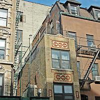 Skinny Tenement Building