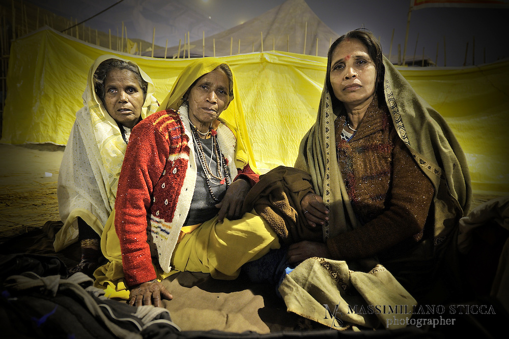 After Holy Bath on Mauni Amawasya day a group of women, who cannot afford a tent, pass over the night on the banks of Sangam, waiting for the early morning to go back home..