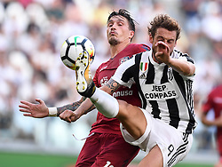 TURIN, Aug. 20, 2017  Cagliari's Fabio Pisacane (L) vies with Juventus' Claudio Marchisio during the Serie A soccer match between Juventus and Cagliari in Turin, Italy, Aug. 19, 2017. Juventus won 3-0. (Credit Image: © Alberto Lingria/Xinhua via ZUMA Wire)