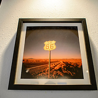 A photograph by Eric O'Connell hangs on display as part of a Double Six Gallery Route 66 themed show in Grants Monday.