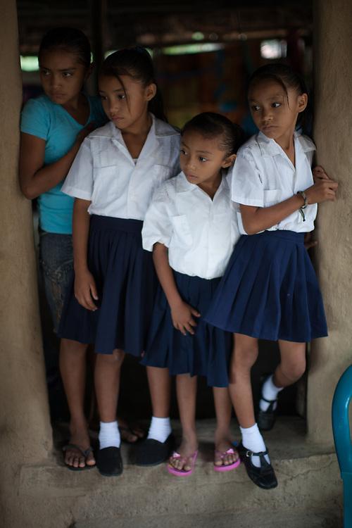 Schoolgirls in a doorway in El Burrillo, Valle, Honduras