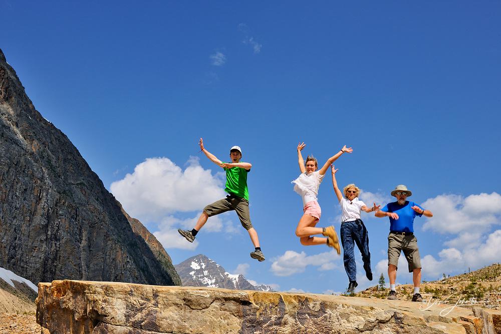 Tourists frolicking below Mt. Edith Cavell, Jasper National Park, Alberta, Canada